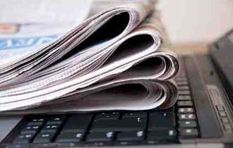 Newspapers Still Reach the Affluent, Educated