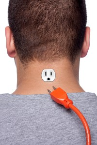 man with electrical plug in neck